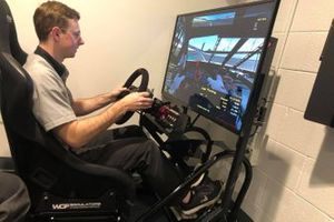 A Hendrick Motorsports team member tests out the sim rig