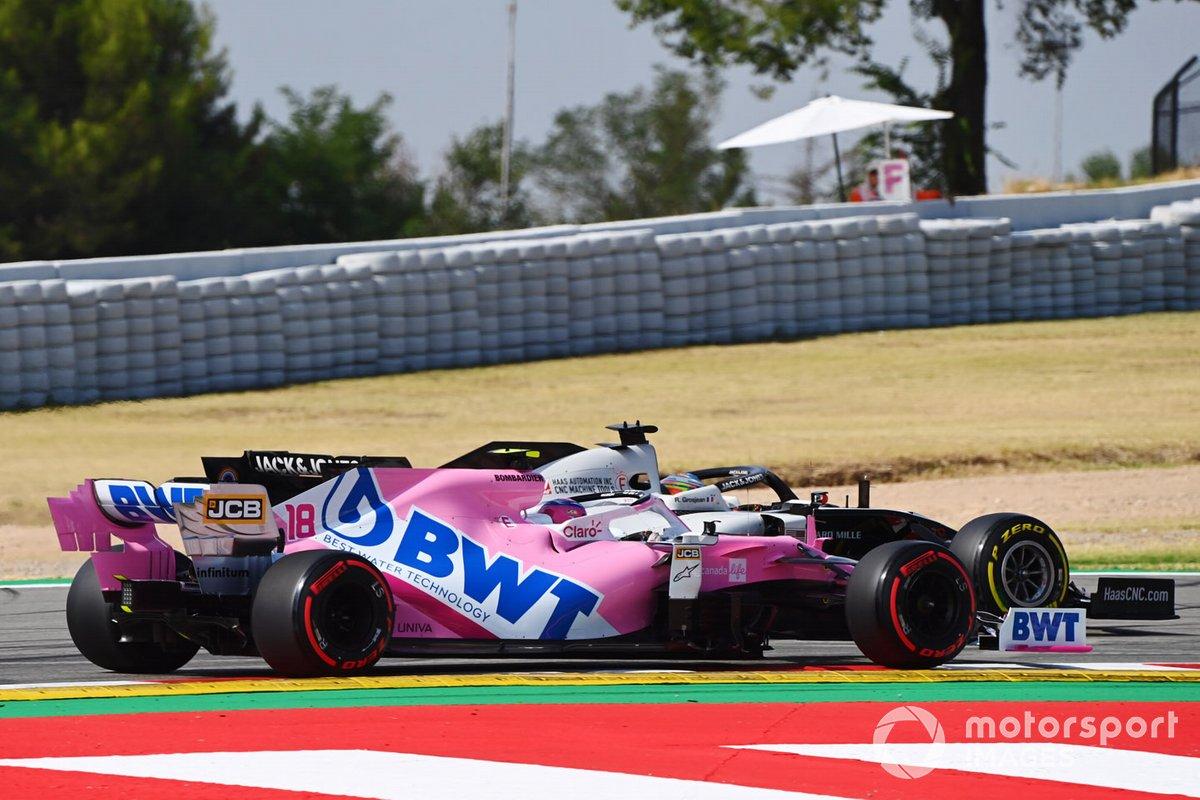 Romain Grosjean, Haas VF-20 leads Lance Stroll, Racing Point RP20