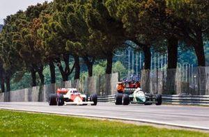 Alain Prost, McLaren MP4-2B TAG, alongside Manfred Winkelhock, RAM 03 Hart