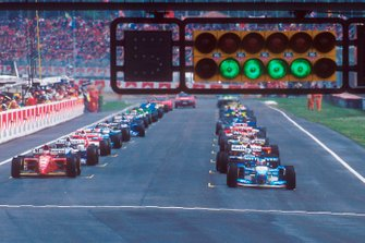 Michael Schumacher, Benetton B195 Renault, and Gerhard Berger, Ferrari 412T2 start on the front row of the grid