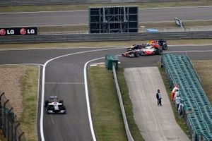 Sebastian Vettel, Red Bull Racing RB6, Lewis Hamilton, McLaren MP4-25 Mercedes, crash at he entrance of the pitlane