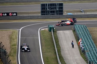 Sebastian Vettel, Red Bull Racing RB6, Lewis Hamilton, McLaren MP4-25 Mercedes, crash at he entrance of the pitlane
