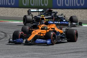 Lando Norris, McLaren MCL35, leads Alex Albon, Red Bull Racing RB16, and Lewis Hamilton, Mercedes F1 W11 EQ Performance