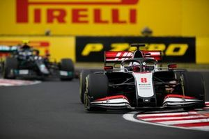 Romain Grosjean, Haas VF-20, leads Valtteri Bottas, Mercedes F1 W11