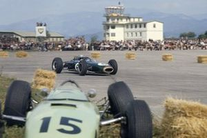 Jack Brabham, Brabham BT11 Climax passes the crashed car of Trevor Taylor, BRP 1 BRM