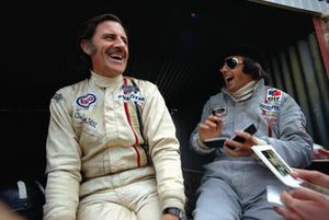 Graham Hill shares a joke with Jackie Stewart during practice