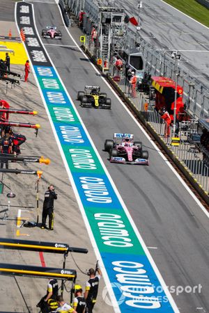 Lance Stroll, Racing Point RP20, leads Esteban Ocon, Renault F1 Team R.S.20, and Sergio Perez, Racing Point RP20, out of the pit lane