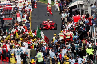 Race winner Kimi Raikkonen, Ferrari F2007 arrives in parc ferme