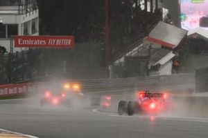 The Safety Car Max Verstappen, Red Bull Racing RB16B, and George Russell, Williams FW43B, out of the pits