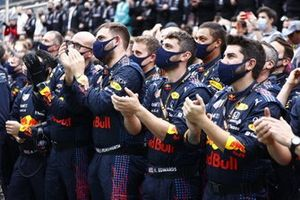 The Red Bull team gather for the podium ceremony