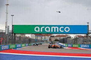 Lando Norris, McLaren MCL35M, George Russell, Williams FW43B, and Lance Stroll, Aston Martin AMR21