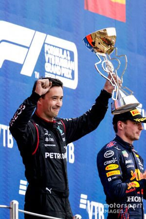 The Mercedes representative lifts the Constructors trophy