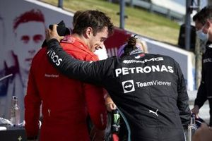 Charles Leclerc, Ferrari, 2nd position, and Lewis Hamilton, Mercedes, 1st position, in Parc Ferme