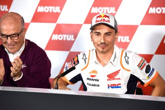 Carmelo Ezpeleta, CEO Dorna Sports with Jorge Lorenzo, Repsol Honda Team announcing retirement