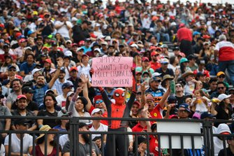 A fan dressed as Spiderman with a message to Charles Leclerc, Ferrari
