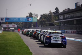 The Jaguar I-Pace eTrophy cars lined up on circuit