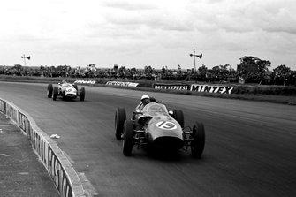 Maurice Trintignant, Aston Martin DBR5/250, leads Jim Clark, Lotus 18 Climax