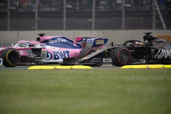 Sergio Perez, Racing Point RP19, leads Romain Grosjean, Haas F1 Team VF-19