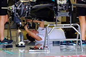 Mechanic at work on the Mercedes AMG F1 W10