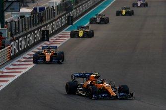 Lando Norris, McLaren MCL34, leads Carlos Sainz Jr., McLaren MCL34, Daniel Ricciardo, Renault F1 Team R.S.19, Kevin Magnussen, Haas F1 Team VF-19, and Nico Hulkenberg, Renault F1 Team R.S. 19