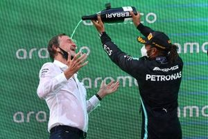 Lewis Hamilton, Mercedes, 1st position, pours Champagne over his team mate on the podium