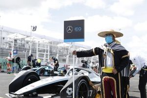 A grid model in traditional costume with the car of Nyck de Vries, Mercedes-Benz EQ, EQ Silver Arrow 02