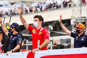 Sergio Perez, Red Bull Racing, Charles Leclerc, Ferrari, and Max Verstappen, Red Bull Racing, in the drivers parade