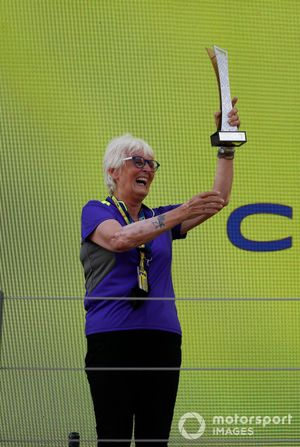 Motor racing veteran Annie Bradshaw on the podium