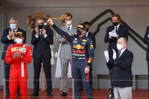 Carlos Sainz Jr., Ferrari, 2nd position, and Max Verstappen, Red Bull Racing, 1st position, on the podium