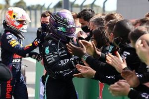 Max Verstappen, Red Bull Racing, 2nd position, and Lewis Hamilton, Mercedes, 1st position, celebrate with their teams in Parc Ferme