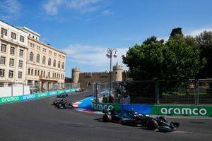 Sebastian Vettel, Aston Martin AMR21, Valtteri Bottas, Mercedes W12, and Esteban Ocon, Alpine A521