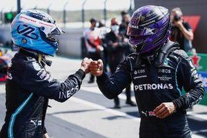 Pole man Valtteri Bottas, Mercedes, is congratulated by Lewis Hamilton, Mercedes, in Parc Ferme