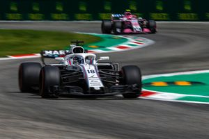 Lance Stroll, Williams FW41 and Esteban Ocon, Racing Point Force India VJM11