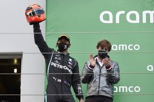 Lewis Hamilton, Mercedes-AMG F1, 1st position, arrives on the podium with the helmet of Michael Schumacher after equalling his race win record of 91