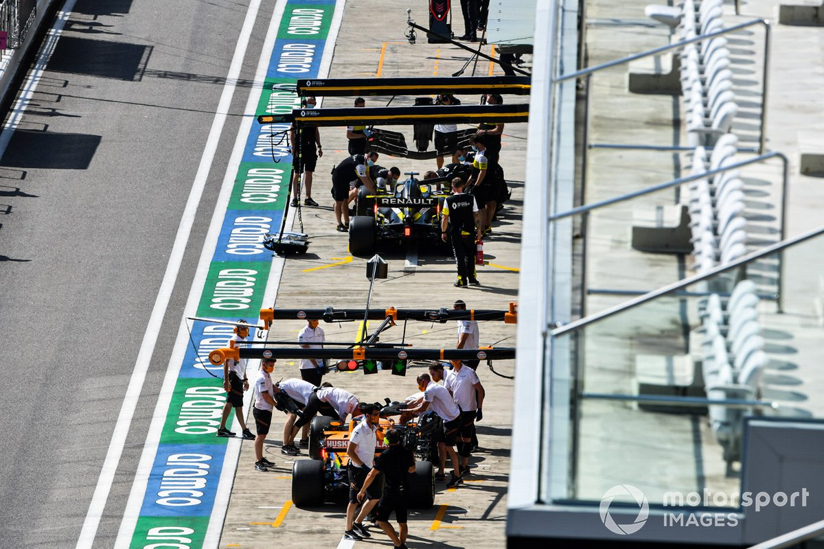 Daniel Ricciardo, Renault F1 Team R.S.20, and Carlos Sainz Jr., McLaren MCL35, in pit lane