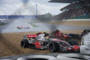 Lewis Hamilton, McLaren MP4-22 Mercedes and Scott Speed, Toro Rosso STR2 Ferrari slide into the gravel as Anthony Davidson, Super Aguri SA07 Honda drifts