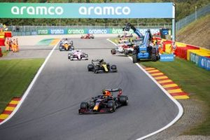 Alex Albon, Red Bull Racing RB16, Esteban Ocon, Renault F1 Team R.S.20, Lance Stroll, Racing Point RP20, and Lando Norris, McLaren MCL35, past the scene of the crash for Antonio Giovinazzi, Alfa Romeo Racing C39, and George Russell, Williams FW43