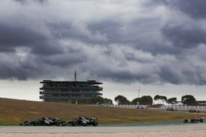 Valtteri Bottas, Mercedes F1 W11, battles with Lewis Hamilton, Mercedes F1 W11, at the start