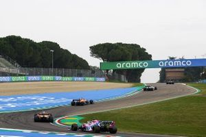 Lando Norris, McLaren MCL35, Carlos Sainz Jr., McLaren MCL35, and Sergio Perez, Racing Point RP20