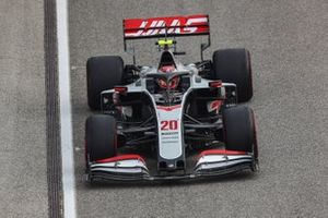 Kevin Magnussen, Haas VF-20, heads to the grid