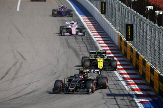 Kevin Magnussen, Haas F1 Team VF-19, leads Nico Hulkenberg, Renault F1 Team R.S. 19, and Lance Stroll, Racing Point RP19