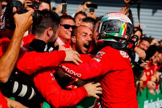 Race winner Charles Leclerc, Ferrari celebrates in Parc Ferme with his Ferrari team