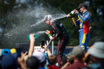 Will Power, Team Penske Chevrolet, Felix Rosenqvist, Chip Ganassi Racing Honda, Alexander Rossi, Andretti Autosport Honda celebrate on the podium
