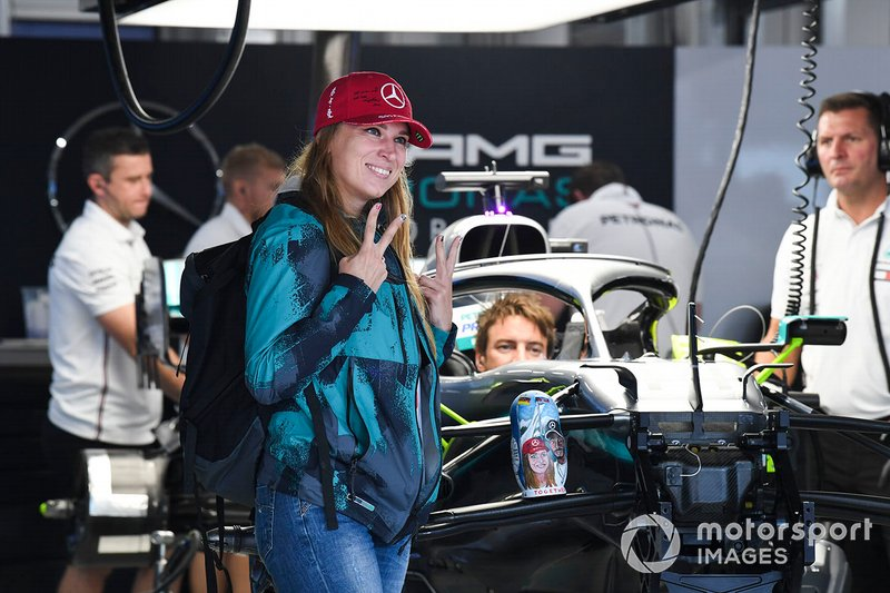 Fans pose in the AMG Mercedes garage