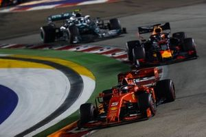 Sebastian Vettel, Ferrari SF90, leads Max Verstappen, Red Bull Racing RB15, and Valtteri Bottas, Mercedes AMG W10