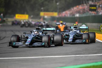 Lewis Hamilton, Mercedes AMG F1 W10, leads Valtteri Bottas, Mercedes AMG W10, Lando Norris, McLaren MCL34, and the remainder of the field on the opening lap