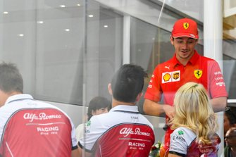 Charles Leclerc, Ferrari, visits the Alfa Romeo Racing hospitality area