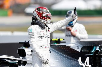 Pole sitter Lewis Hamilton, Mercedes AMG F1, celebrates on the grid