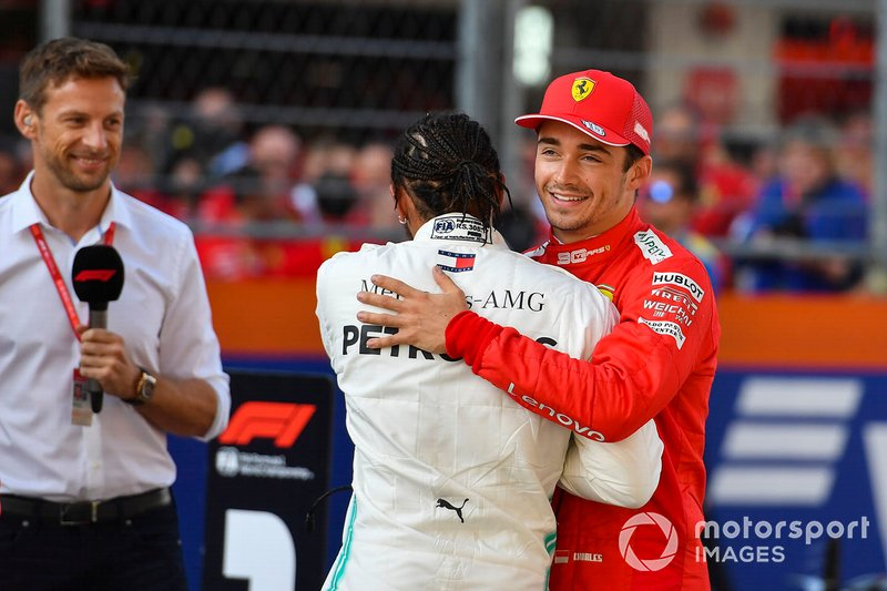 Pole winner Charles Leclerc, Ferrari, is congratulated by Lewis Hamilton, Mercedes AMG F1. Jenson Button