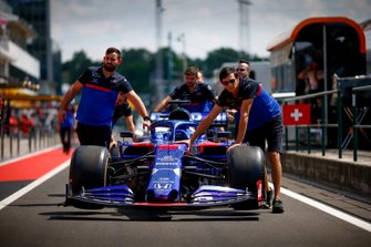 Car of Daniil Kvyat, Toro Rosso STR14 being pushed down the pit lane by mechanics